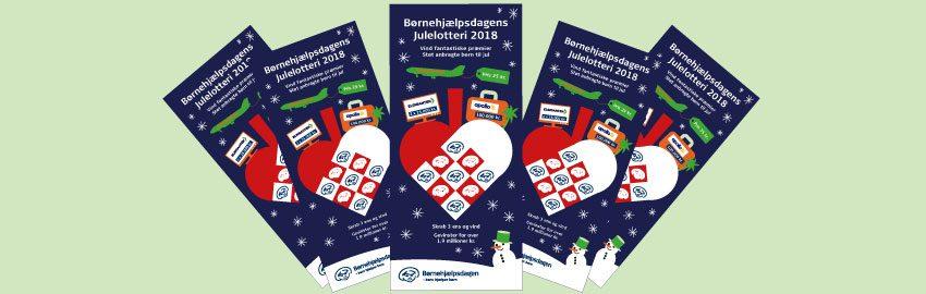 Børnehjælpsdagen har to årlige skrabelotterier - Julelotteriet og Lillebror Lotteriet. Her ses det aktuelle Julelod.